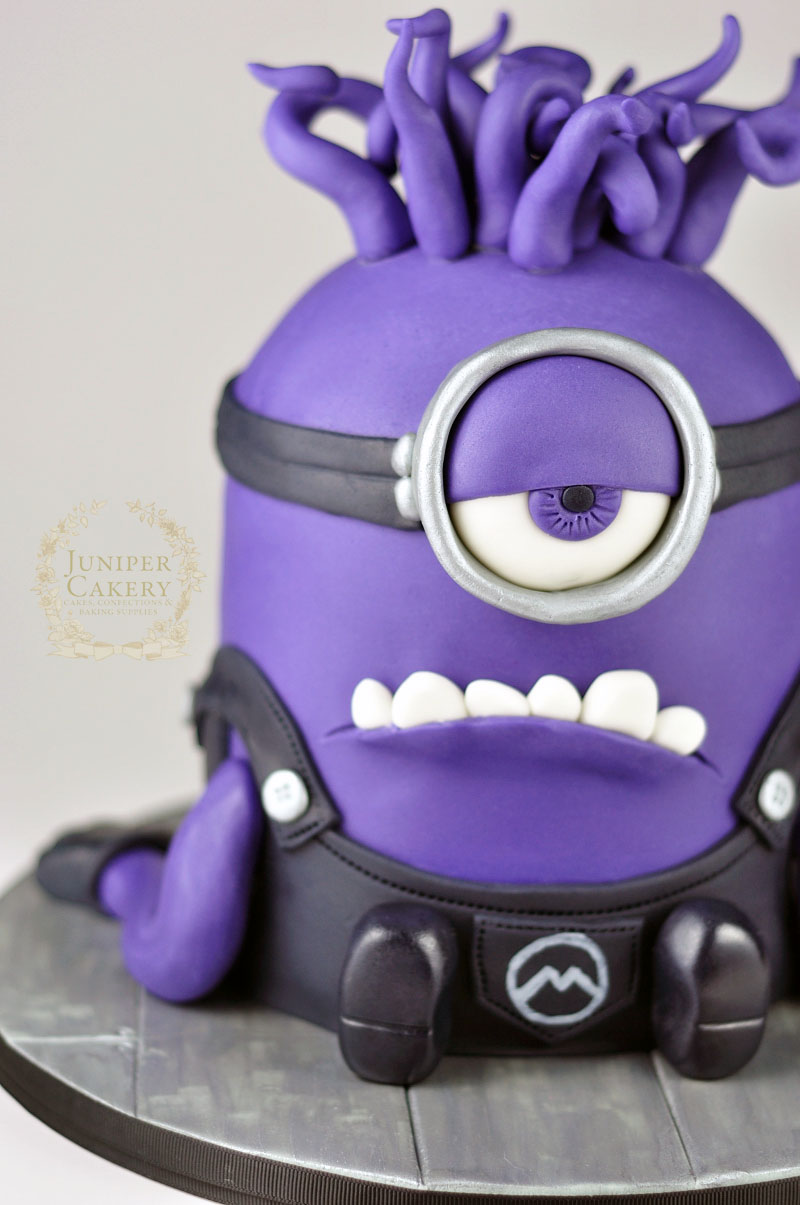 Fun purple minion birthday cake by Juniper Cakery