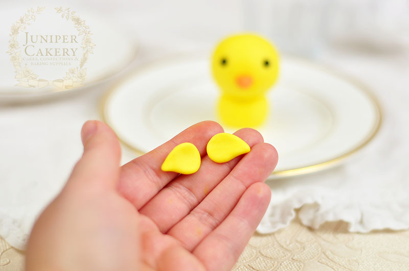 Make a cute chick from fondant with this tutorial by Juniper Cakery
